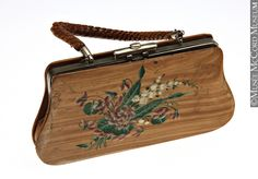 Purse. About 1890, 19th century. Painted wooden, leather, metal. M983.102.7 | Unusual purse of painted wood.