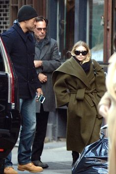 Ashley Olsen was spotted in New York City with Richard Sachs, bundled up in a scarf, oversized coat, jeans and boots. Pair the look with some oversized sunglasses and you're good to go!