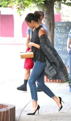 Selena Gomez adds drama with wrap, would've used a turquoise clutch..