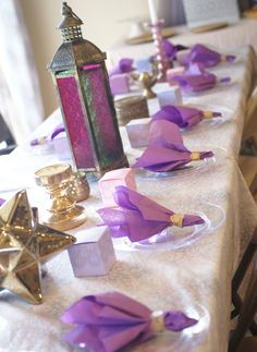 Muted Moroccan: Shades of Purple and Gold Baby Shower. Could use basic clear lantern with tissue paper inside and led tea lights Gold Bridal Showers, Gold Baby Showers, Baby Shower Games, Baby Shower Parties, Shower Baby, Baby Decor, Baby Shower Decorations, Bollywood Baby Shower, Arabian Party
