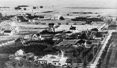 1907)^ - Panoramic view of Hollywood in 1907, looking southeast from Franklin Avenue near Orange Drive. Hollywood High School is in the center of the photo, facing Highland Avenue, with vacant lands beyond. The Hollywood Hotel is at left, facing Hollywood Blvd. Orchid Street is at left. Quite a few houses are seen, and electric power poles line the streets.