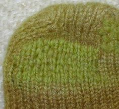 Good tutorial on repairing a hole in a sock using the duplicate stitch plus vertical thread guideline method.  http://www.hjsstudio.com/darn.html