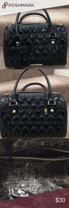 "Betsey Johnson black satchel bag purse duffel Large solid Black satchel. Very roomy inside Approx size 14 x 9 x 7 with 8"" drop handle.  Has removable tassel bow hardware and  3 pockets inside Plus a long inside key holder pre-owned in perfect condition - no sign of any wear this bag looks great! Betsey Johnson Bags Totes"