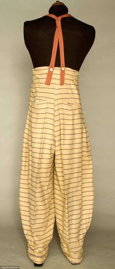 """* MAN'S WOOL ZOOT SUIT, N.J., 1938-1942 New York City 2 different pattern striped wools, long fitted coat, oversize padded shoulders & exterior pouch pockets, red plastic buttons, high-waist balloon pants, pegged cuffs, 4 slash pockets, crudely made suspenders in cinnamon wool, Sh-Sh 26"""", Ch 45"""", Jacket L 41"""", High W (taken in) 32"""", Outseam 50.5"""", Inseam 31"""", (large L-shaped tear near 1 pant pocket, darning on jacket's L shoulder) very good. From Newark, N.J. area"""