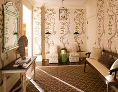 Apartment Foyer Stenciled wall paintings based on 18th-century wallpaper in Sweden's Drottningholm Palace Theater bring fresh air and drama into the foyer of a New York apartment. Designer Timothy Whealon extended the alfresco theme with a green lacquer David Hicks garden seat and lattice-motif Madeline Weinrib Brooke rug in Chocolate.