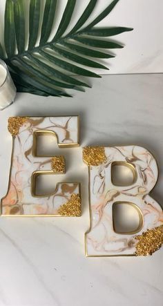 """Resin wooden letter blocks. """"E"""" """"B"""" . White marbled with hint of peach . Gold accent withgold foil flakes. Luxury resin art. Resin Wall Art, Diy Resin Art, Diy Resin Crafts, Letter Blocks, Diy Resin Projects, Gold Leaf Art, Resin Jewelry Making, Acrylic Pouring Art, Resin Tutorial"""