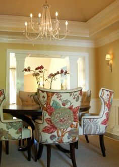 Love the large-scale fabric on the chairs in an otherwise subdued room.