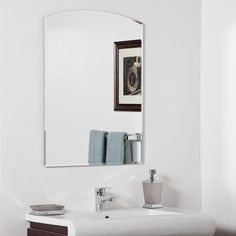 Strike a pose in front of this stylish and super modern frameless wall mirror with a deep bevel border. This mirror is perfect for a hallway, living room or bathroom.