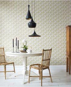 Combine geometric wallpaper with a trio of Tom Dixon's Beat pendants.