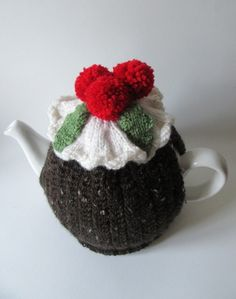 A wonderful hand knitted Christmas pudding tea cosy. The body of the cosy is knitted in a brown speckly yarn giving the appearance of a dried fruit pudding. The stitch I have used is called stem stitch, and looks like an oversized rib which lends itsel. Christmas Pudding, Christmas Tea, Christmas Is Coming, Christmas Crafts, Holly Berries, Holly Leaf, Hand Knitting, Knitting Patterns, Crochet Patterns