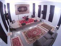 Carpet on the wall - good idea! Nice looking concrete floors with carpets