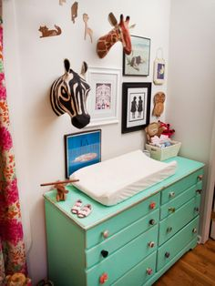 A tall, basic dresser becomes a bohemian changing table with the addition of mismatched knobs and a cheery aqua hue.