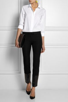 Go-to for expertly cut essentials. This classic white shirt has a boxy, loose cut and the crisp cotton-poplin holds its shape. Make it work for the boardroom or bar with tailored pants and heels.