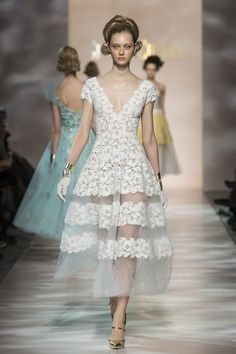 Model wears a creation by Georges Chakra Haute Couture summer 2015
