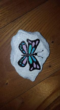 Butterfly free hand painted Rock