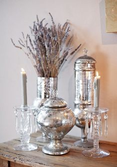 Photographer Aaron Delesie displays his grandmother's crystal candlesticks among the mercury glass left over from different events that he and his wife have photographed. Photo by Aaron Delesie. Decor, Candle Holders, Silver Decor, Mercury Glass, Decor Design, Design Sponge, Glass, Crystal Candlesticks, Vintage Chic