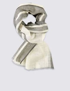 Perfect for dressing up or down, this scarf will lift any look. Stylish stripes give this scarf a jaunty polish.