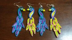 a video tutorial on how to make these long Peacock Quilled earrings https://www.youtube.com/watch?v=cLI-3ej_eZ4