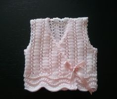 http://www.ravelry.com/projects/sevkut/baby-girl-vest-3: