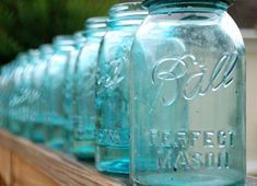 Blue mason jars, tied with twine / add pale yellow freesias and herbs