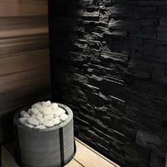 Tulikivi Tuisku sauna heater with soapstone cladding & white decorative sauna stones.