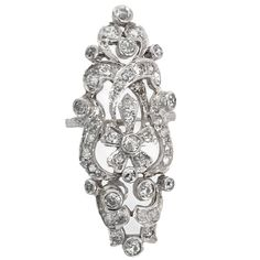 Edwardian Swirl Design Diamond Platinum Dinner Ring. A delightful swirl of platinum surrounds approx. 2 carats of diamonds in this impressive and substantial dinner ring. c 1915
