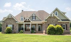 Welcoming home with double front doors and porch.  #homes #homeexteriors homechanneltv.com