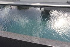 Swimple glass mosaic tiles offer you a beautiful affordable and quality mosaic tile for your swimming pool or building project. Pool Colors, Colours, Pool Tiles, Glass Mosaic Tiles, Backyard Ideas, Mosaics, Swimming Pools, Porch, Charcoal