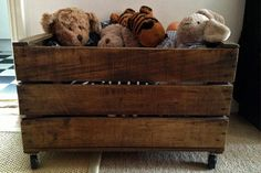 Vintage wooden crate turned into handy storage for kids toys.