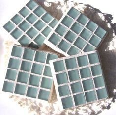 These Mosaic Coasters are done in a beautiful Seafoam. These Coasters are a set of 4 coasters made with 1/4 inch thick frosted glass tiles