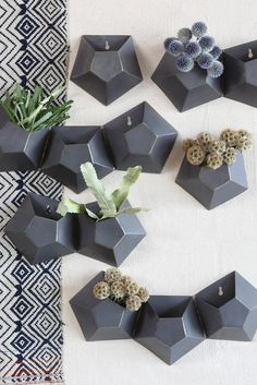"""Double Hexagonal Iron Wall VasePerfect for indoor or outdoor, this iron wall vase is a unique approach to hanging plants. - Dual hexagonal shaped vases - Ready to hang - 12"""" L x 2.5"""" W x 6"""" H"""