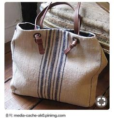 grain sack bag - I like the knotted leather handles.alternative to sewing leather handles. large grommets and recycled leather belts.Canvas tote with leather handles.Handbags are the banks where women deposit all their beauty tricks. Handbags help a Sacs Tote Bags, Tote Purse, Sack Bag, Grain Sack, Linen Bag, Burberry Handbags, Burberry Bags, Fabric Bags, Black Cross Body Bag