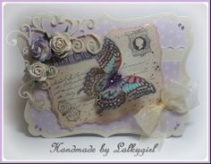 a card I have made using a joycrafts postcard stamp,dovecraft back to basics papers,wild orchid flowers,promarkers and ribbon and gems from meiflower crafts