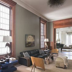 "by Neuhaus Design Architecture, P.C.  ""Hi, Thank you for your question. The paint color is BM Hampshire Gray"
