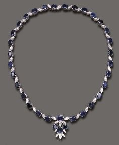 A SAPPHIRE AND DIAMOND NECKLACE   Composed of a series of oval-cut sapphires and marquise-cut diamonds, the front suspending a cluster of similar design, mounted in white gold, 16½ ins.