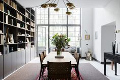 Dining Space With Huge Windows In A Stockholm Townhouse In An Old Brewery With Amazing Windows - Gravity Home