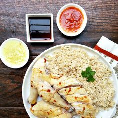 Hainan chicken, a Singaporean dish consisting of flavorful chicken and rice accompanied with a ginger garlic sauce and chili sauce.