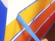 Painting Horizontal Stripes - A single wall painted with horizontal stripes can completely change the look of a room.