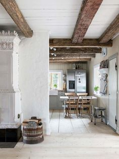 decordemon: A raw yet cozy wooden cottage in Sweden Scandinavian Cottage, Swedish Cottage, Wooden Cottage, Bohemian Chic Home, Swedish Interiors, Farmhouse Interior, Beautiful Interiors, Cabana, Home Kitchens