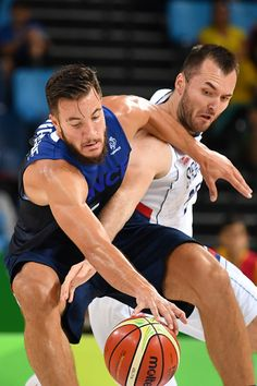 #RIO2016 France's power forward Joffrey Lauvergne works around Serbia's power forward Milan Macvan during a Men's round Group A basketball match between...