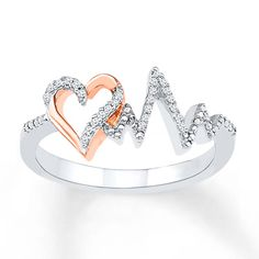 This expressive ring for her features a 10K rose gold heart complemented by a sterling silver heartbeat, both decorated in round diamonds. The ring has a total diamond weight of 1/15 carat. Diamond Total Carat Weight may range from .065 - .08 carats.