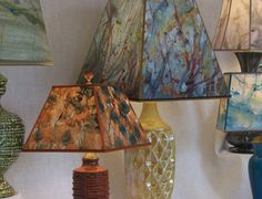 dana shades and lamps.  Handmade paper, or perhaps paint splatters reminiscent of Jackson Pollack's style.