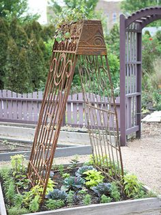 Transform a small bed into a lush centerpiece with two vintage garden gates turned into a trellis. At harvesttime, everything in this showpiece bed is conveniently within arm's reach.