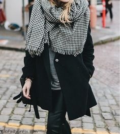 Classic black coat and cozy scarf for winter street style. #winter #coat #scarf