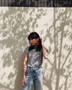 gray tee + jeans + tassel earrings.