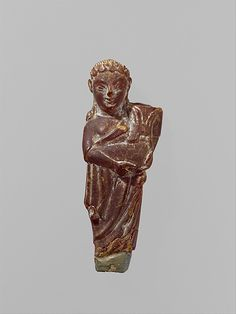 Pendant: woman carrying a child Period: Archaic or Classical Date: century B. Culture: Etruscan Medium: Amber Dimensions: H. Ancient Goddesses, Ancient Myths, Ancient Rome, Ancient Greece, Ancient Art, Ancient History, Collections D'objets, Archaeological Discoveries, Ancient Jewelry