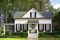 Love the sunporch on the side.