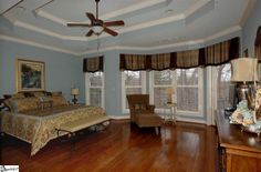 Gorgeous tray ceiling in this beautiful Simpsonville, SC home. Blue master bedroom. Listed by CB Caine agent Mary Jane Freeman.