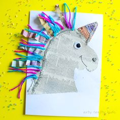 Re-purpose newspaper and craft scraps to create this adorable Mixed Media Paper Unicorn Craft. A fun and easy art project for kids!