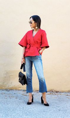 A red kimono wrap top looks so chic with frayed cropped flares and block heels.